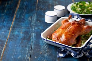 Roast duck in enamel baking dish