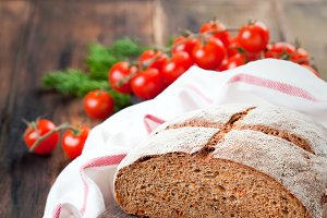 Homemade whole wheat bread with sundried tomatoes and herbs