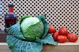 bottle, cabbage and red tomatoes