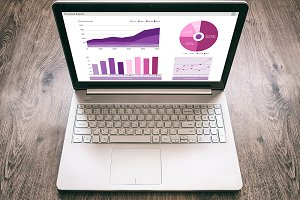 Laptop with Financial report charts