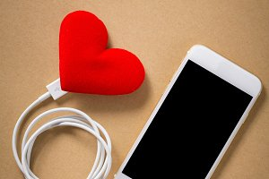 Blank smartphone and heart