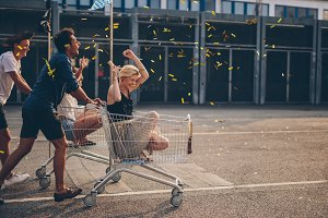 Friends racing with shopping cart