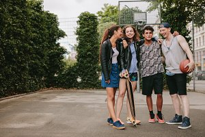 Teenage friends with skateboard