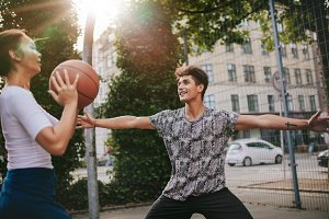 Teenage friends playing streetball
