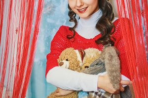 Beautiful young girl with soft bear