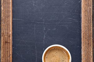 Coffee cup on vintage chalk board