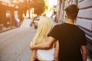 couple are walking on the street