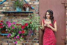 The girl at a brick wall.