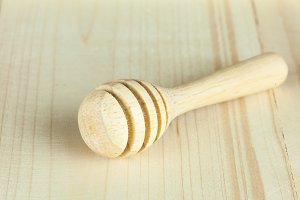 honey dipper without honey on wooden background