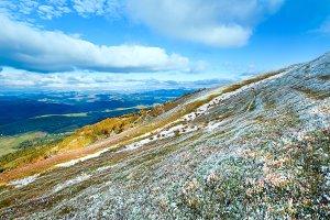 First snow in autumn mountain