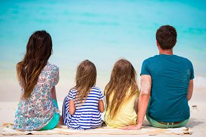 Young family of four on the beach