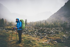 Traveler Man with backpack hiking