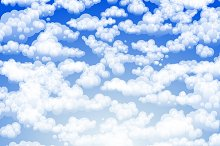 light clouds in a blue sky vector