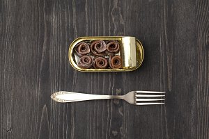 Anchovies can with fork