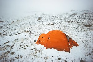 Tent camping in winter mountains