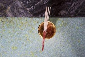 Incense in marble floor