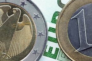 Euro coins on euro banknote close up