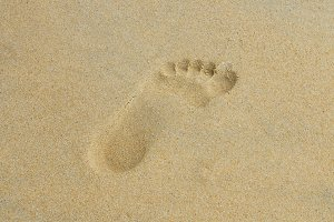 Trace of a bare foot on wet sand