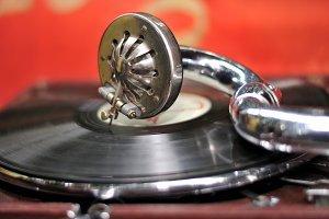Old gramophone head and vinyl disc