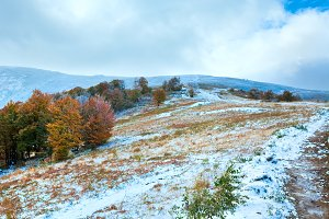 First snow in autumn mountain