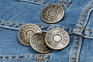 Jeans metal buttons on denim