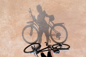 Shadow of the bicycle and the girl