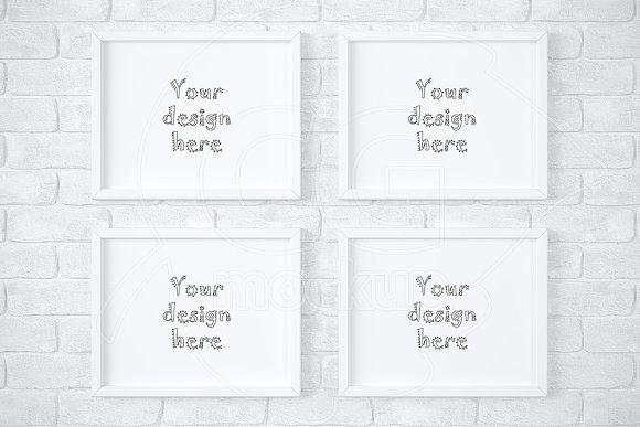 4 white frames on brick wall mockup