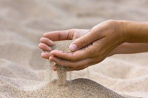 sand running through fingers