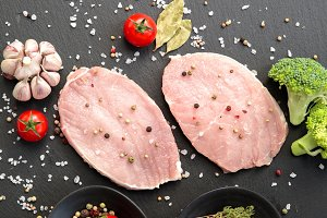 Raw pork chops meat with spices