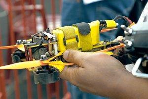 Modern handmade FPV drone in man's hands