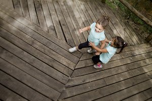 Girls playing on wooden floor