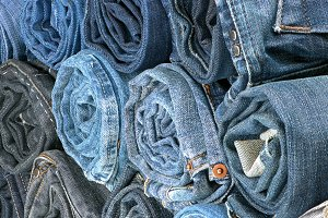 Stack of rolled colored jeans
