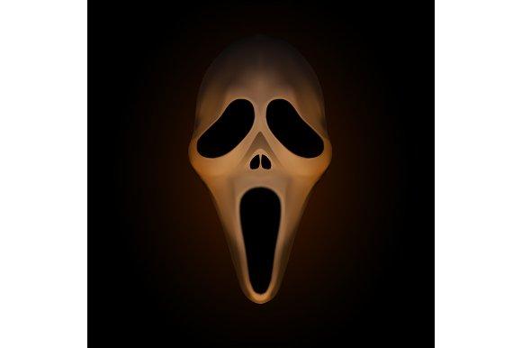 Spooky halloween mask on dark brown