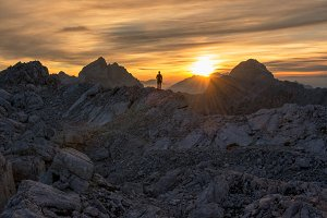Male hiker in mountains at sunset