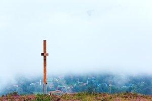 Wooden cross on summer mount