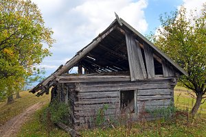 wooden rotten barn in mountain