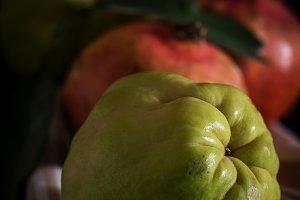 Fresh quinces and pomegranates