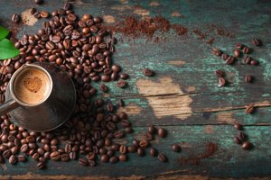 Hot coffee on a wooden background