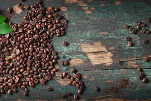 Coffee beans on an old background