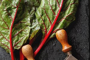 Swiss rainbow chard, vibrant vegetable. Flat lay, from above on dark slate. Top view