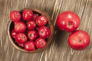 Red apples in a timber bowl