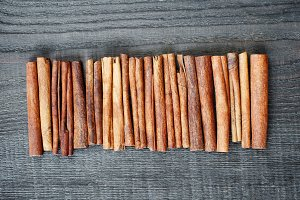 Cinnamon sticks on the wooden table