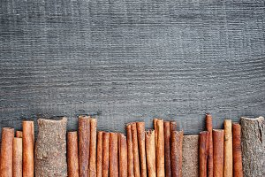 Wooden background with cinnamon