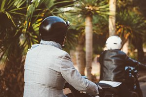 Men in helmets riding bikes