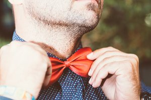 Man wearing red bow tie