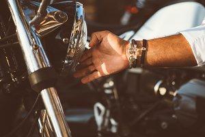 Man touching moto headlight