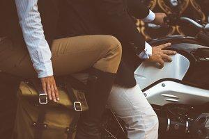 Couple sitting on motorbike