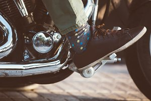 Biker shoe on throttle pedal