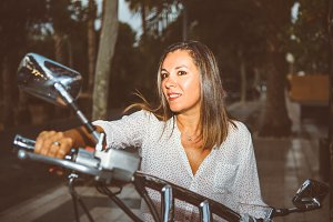 Attractive woman on motorbike