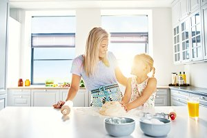 Loving mother and daughter baking in the kitchen